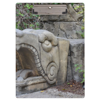 dragon head sculpture with plants clipboard