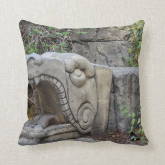 dragon head sculpture with plants throw cushions