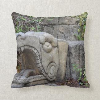 dragon head sculpture with plants throw cushions