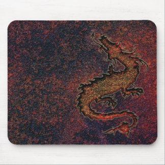 dragon on rusty metallic background mouse mats