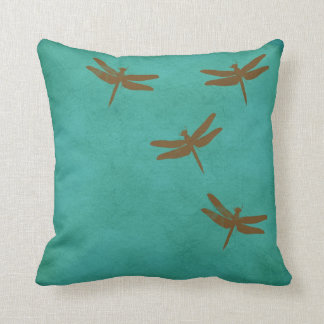 Dragonflies and teal coloured pillow