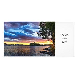Dramatic sunset at lake photo card