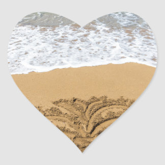 Drawing of palm tree on sandy beach heart sticker