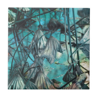 dried waterlily and reflection on lake in autumn ceramic tile