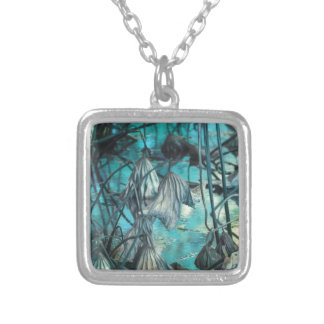 dried waterlily and reflection on lake in autumn silver plated necklace