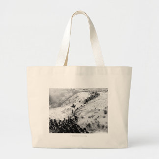 Driving cattle in the winter. large tote bag