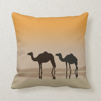 Dromedary camels and a mirage cushion