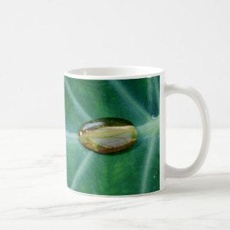 Drop of rain on a green leaf classic white coffee mug