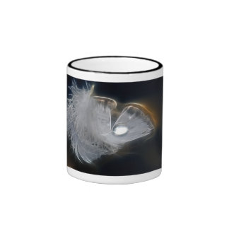 Droplet of water on a white feather mugs