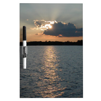 dry erase board with photo of silver-lining sunset