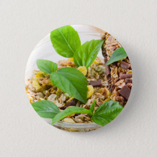 Dry mix of muesli and cereal in a bowl of glass 6 cm round badge