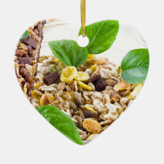 Dry mix of muesli and cereal in a bowl of glass ceramic heart decoration