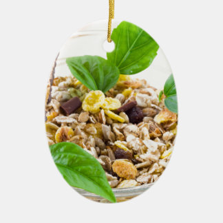 Dry mix of muesli and cereal in a bowl of glass ceramic oval decoration