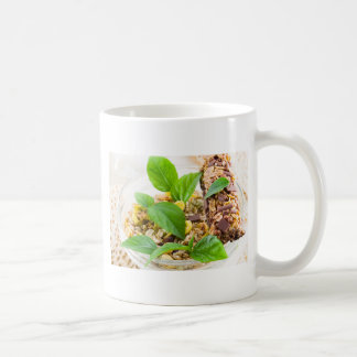 Dry mix of muesli and cereal in a bowl of glass coffee mug