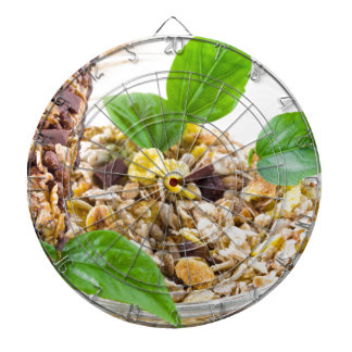 Dry mix of muesli and cereal in a bowl of glass dartboard
