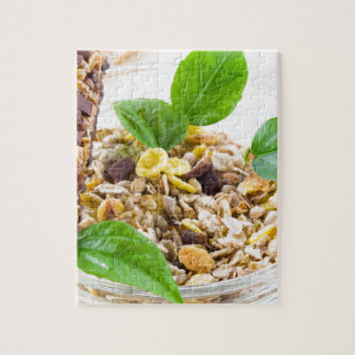 Dry mix of muesli and cereal in a bowl of glass jigsaw puzzle