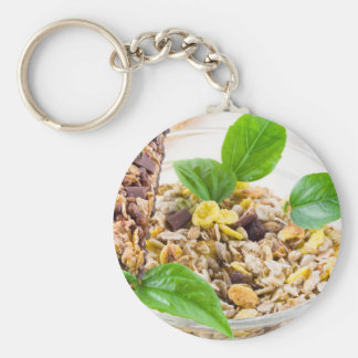 Dry mix of muesli and cereal in a bowl of glass key ring