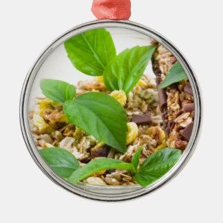 Dry mix of muesli and cereal in a bowl of glass metal ornament