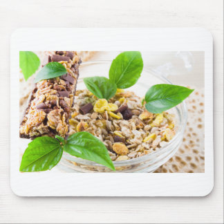 Dry mix of muesli and cereal in a bowl of glass mouse pad