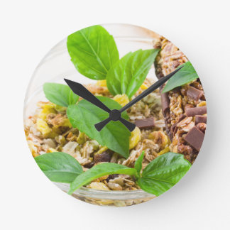 Dry mix of muesli and cereal in a bowl of glass round clock