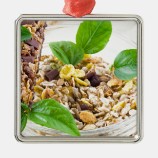 Dry mix of muesli and cereal in a bowl of glass Silver-Colored square decoration