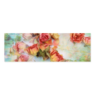 Dry roses on green vintage pack of skinny business cards