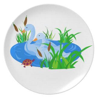 Ducks in water plate