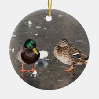 """ducks on black ice"" ceramic ornament"