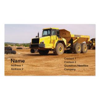 dump truck by dirt pack of standard business cards