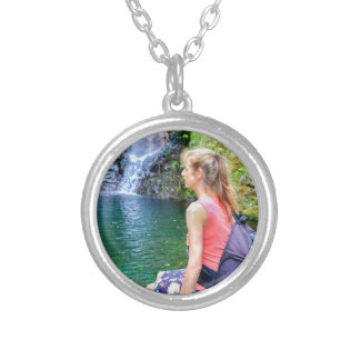 Dutch woman sitting on rock near waterfall silver plated necklace