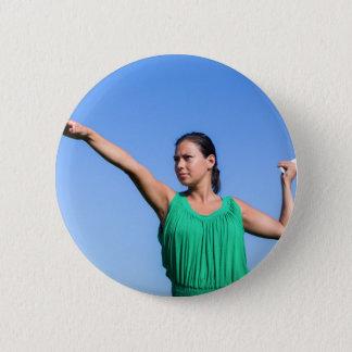 Dutch woman throwing boomerang in blue sky 6 cm round badge