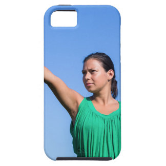 Dutch woman throwing boomerang in blue sky iPhone 5 cases