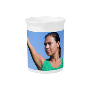 Dutch woman throwing boomerang in blue sky pitcher