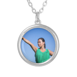Dutch woman throwing boomerang in blue sky silver plated necklace
