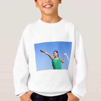 Dutch woman throwing boomerang in blue sky sweatshirt