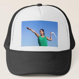 Dutch woman throwing boomerang in blue sky trucker hat
