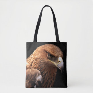 Eagle portrait isolated on black tote bag