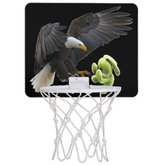 Eagle scares to a teddy mini basketball hoop