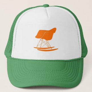 Eames rocker chair in orange trucker hat