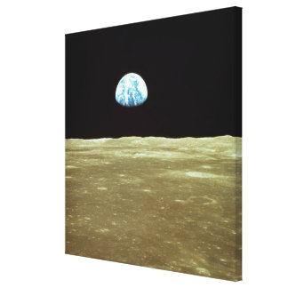 Earth rising over Moon Stretched Canvas Prints