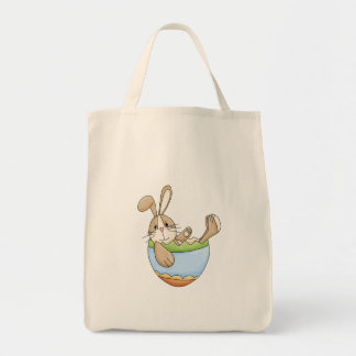 easter bunny lounging in egg bag