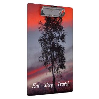 Eat Sleep Travel Stormy sunset clipboard