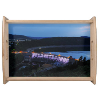 Edersee lit up concrete dam in the evening serving tray