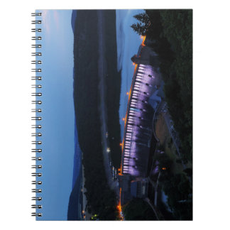 Edersee lit up concrete dam in the evening spiral notebook