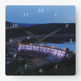 Edersee lit up concrete dam in the evening square wall clock