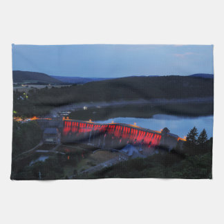 Edersee lit up concrete dam in the evening tea towel