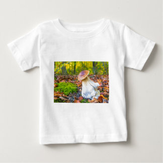 Edible porcini mushroom on forest floor in fall baby T-Shirt