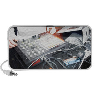 EDM DJ mixing music at an underground show Travel Speaker
