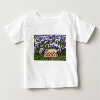 Egg box with chicken eggs in crocuses baby T-Shirt