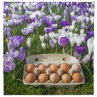 Egg box with chicken eggs in crocuses napkin